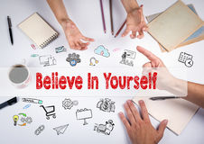 Believe in yourself concept. The meeting at the white office table Stock Photos