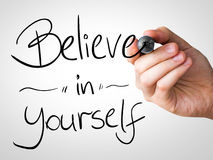 Believe in Yourself hand writing with a black mark on a transparent board.  stock photo