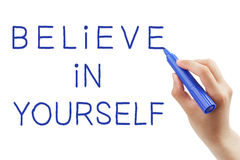 Believe In Yourself. Hand writing Believe In Yourself with blue marker on transparent wipe board Stock Image