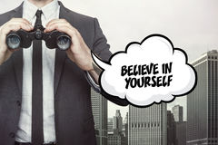 Believe in yourself text on blackboard with businessman Stock Image