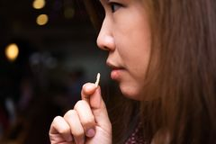 A Holy communion. A believer is eating a bread in a Holy Communion Royalty Free Stock Photo