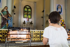 Believer kneel and praying in a Catholic church Royalty Free Stock Photo