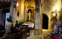 Believers next to Pope John Paul chapel in a mallorcas church. Believer next to Pope John Paul memorial chapel in Saint Miquel church, on the Spanish Balearic Royalty Free Stock Image