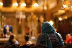 A believer prays in the church of Saint Spiridon in Corfu. Greece landscape old landmark kerkyra greek esplanade square island holidays scene travel royalty free stock photo
