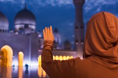 Believer at the mosque. Believer reaching for the sky at the mosque royalty free stock image