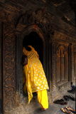 A believer went into a temple. A believer with Royalty Free Stock Photography