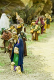 Believers. In queue to give their presents to baby Jesus Stock Photos