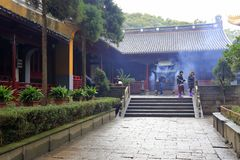 Believers burn incense in Putuoshan Island Scenic area, adobe rgb. Putuo Mountain is an island in the Zhoushan Archipelago, an area of nearly 13 square Royalty Free Stock Images