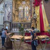 Believers with votiv candles, St. Peter`s Metropolitan Cathedral, Bologna Stock Photos