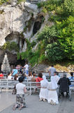 Believers near the Grotto in Lourdes Royalty Free Stock Photography