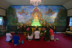 Believers pray in a Wat Saket Temple Royalty Free Stock Image