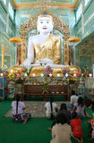Believers in prayer in front of the statue of Buddha at Soon U P Stock Photos