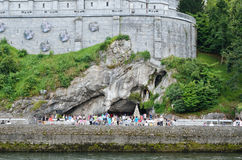Believers and tourists near the Grotto in Lourdes Stock Photography