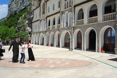 Believers visiting the Ostrog monastery near Danilovgrad on Mont Stock Photography