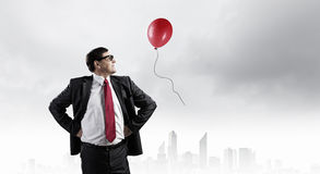 He believes in success. Confident businessman posing with hands on his waist Stock Image