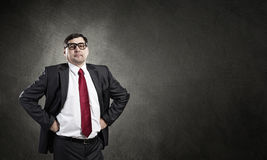 He believes in success. Confident businessman posing with hands on his waist Royalty Free Stock Photography
