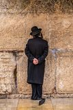Believing pray near the wall of crying in a black hat. Believing pray near the wall of crying in a big black hat royalty free stock photos