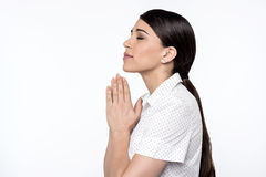 Believing woman praying to God Stock Photo