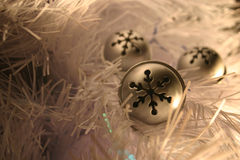 Belils on white. Silver bells in a white christmas tree royalty free stock images