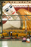 Belivers praying at the pagoda Chaukhtatgy of Yangon Royalty Free Stock Photography