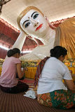 Belivers praying at the pagoda Chaukhtatgy of Yangon Stock Image