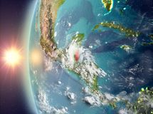 Belize during sunset from space. Belize as seen from space on planet Earth during sunset. 3D illustration. Elements of this image furnished by NASA Royalty Free Stock Photos