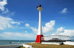 Belize City Lighthouse. The lighthouse with boats passing by in Belize City (Belize Royalty Free Stock Image