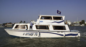 Belize City - Water Taxi and Fishing Boat Stock Photography