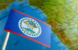 Belize flag with a globe map as a background Stock Images
