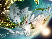 Sun rising above Belize from space. Belize from space with highly detailed surface textures and visible country borders. 3D illustration. Elements of this image Royalty Free Stock Photography