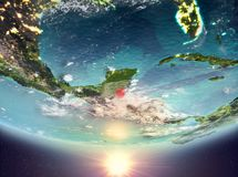 Belize with sun. Belize during sunrise highlighted in red on planet Earth with clouds. 3D illustration. Elements of this image furnished by NASA Stock Photo