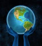 Belize sur terre dans des mains dans l'espace illustration stock