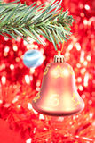 Bell. Red christmas bell on red shiny background Stock Photos