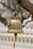 Bell. Brass bell hang by tree Royalty Free Stock Image