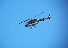 Bell 206 helicopter in flight Stock Image