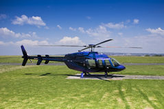 Bell 407 Helicopter - Parked on Helipad Stock Images
