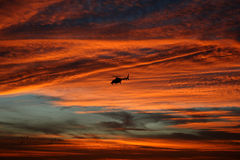 Bell 430 at dusk. A bell 430 helicopter takes off at dusk in the fall sky over Wisconsin Royalty Free Stock Photos
