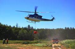 Bell 412 in action. Training firefighters with helicopter Bell 412 for forest fires Royalty Free Stock Photo