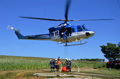 Bell 412 in action. Training firefighters with helicopter Bell 412 for forest fires Stock Photography