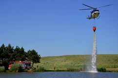 Bell 412 in action. Training firefighters with helicopter Bell 412 for forest fires Stock Photo