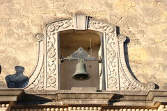 Bell at the Alamo, San Antonio. Old metal bell framed by ornate stone work at the Alamo, San Antonio, TX royalty free stock image