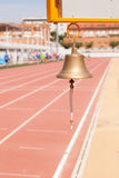 Bell athletics. Athletics bell announcement last lap Royalty Free Stock Image