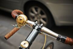 Bell on bicycle handlebar  Stock Photos