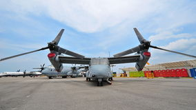 Bell Boeing MV-22 Osprey tilt rotor aircraft on display at Singapore Airshow. SINGAPORE - FEBRUARY 9: Bell Boeing MV-22 Osprey tilt rotor aircraft with vertical stock photo