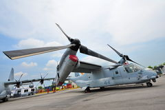 Bell Boeing MV-22 Osprey tilt rotor aircraft on display at Singapore Airshow. SINGAPORE - FEBRUARY 9: Bell Boeing MV-22 Osprey tilt rotor aircraft with vertical royalty free stock images