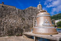 Bell in Budva. Bell next to Old Town walls in Budva, Montenegro Stock Photo