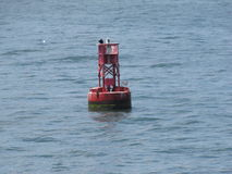 Bell buoy. Warns boats for safe travel in and out of the harbor port in New England Stock Photo