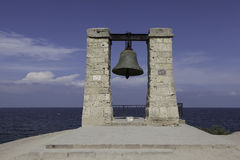 Bell in Chersonese. Crimea. Ukraine. He stands on the seashore. Cast from captured guns in 1776, before he had warned of the danger of ships in conditions of royalty free stock photography