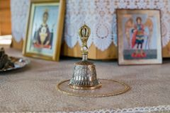 Bell and Christian icons  on the altar in the church. PETROPAVLOVKA, RF - May 31, 2014:Bell and Christian icon of the Archangel Michael on the altar in the Royalty Free Stock Image