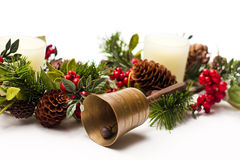 Bell and Christmas arrangement on a white table Stock Photography